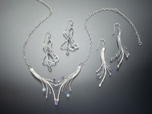 silver jewelry in blue topaz and amethyst